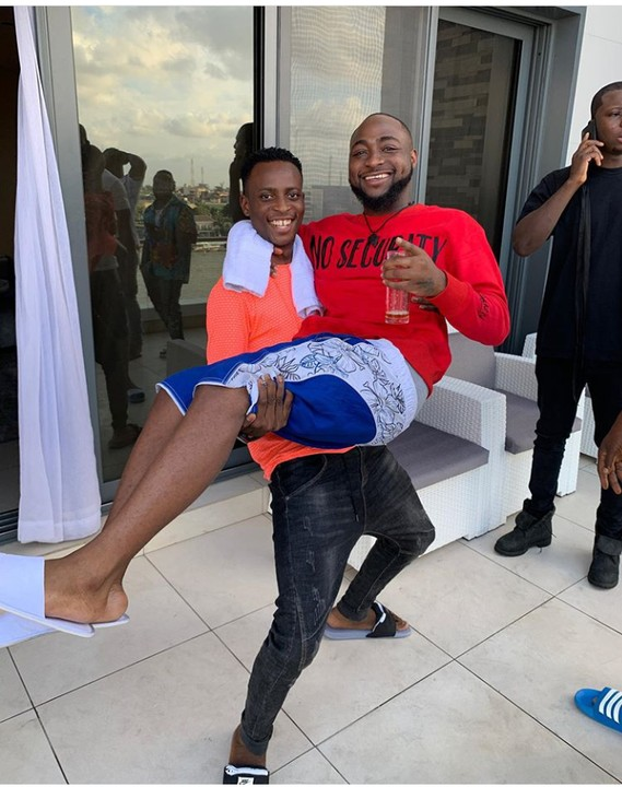 Instagram Comedian Sydneytalker Carries Davido Like A Baby (Photographs)