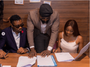 BBNaija Ike while signing the new deal