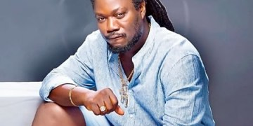 Daddy Showkey Shows Off Length Of His 27-Yr-Outdated Hair (Photograph)