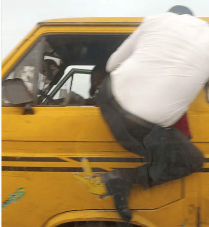 The man while fighting with the danfo driver