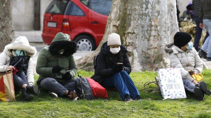 Croatians wear face masks as they sit outside