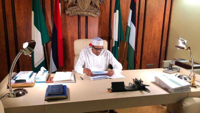 President Buhari at work