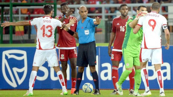 Tunisian Players Confronted Refree Seechurn Rajindrapasard Following their 2-1 Elimination fromAfcon 2015 at the Hands of Equatorial Guinea. Image: AFP.