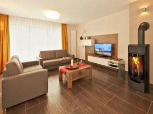Dünenhaus Aurell App.II Wohnzimmer
