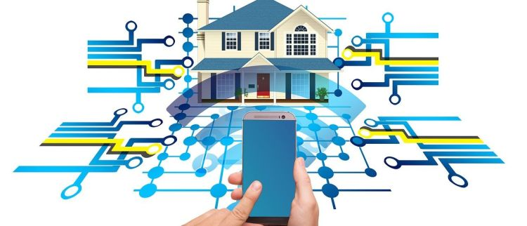 Color photo of a smart home, controlled by a smartphone.