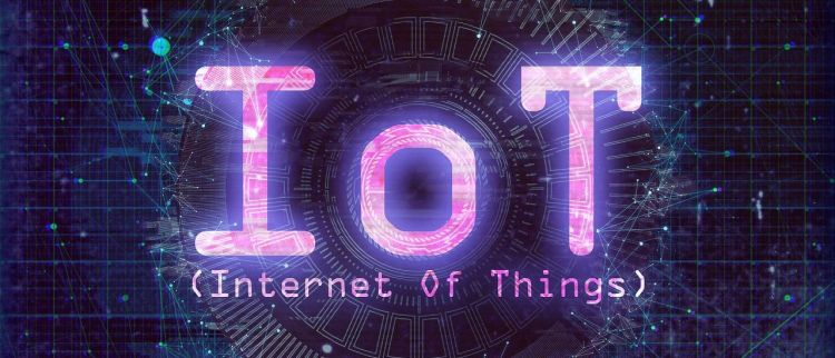 Color photo of an inscription IoT (Internet Of Things), used to illustrate the meaning of security and privacy for IoT.