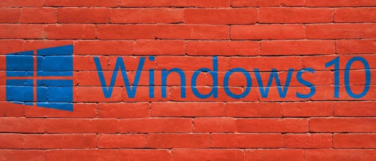 Color photo of Windows logo on a brick wall - used to illustrate the popularity of Windows 10 and Security updates.