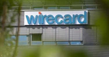 Der Wirecard-Schriftzug am Hauptquartier des Unternehmens in Bayern. Foto: Peter Kneffel/dpa