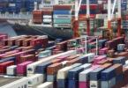 Container stapeln sich in einem Hafen in Yokohama. Japans Wirtschaft ist im Zuge der Corona-Krise weiter massiv eingebrochen. Foto: Koji Sasahara/AP/dpa
