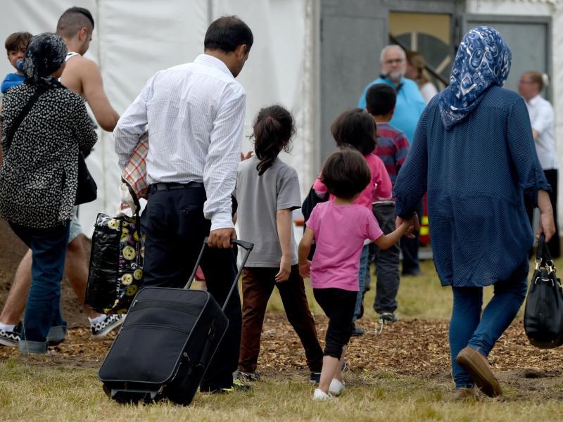Flüchtlinge auf Lesbos. Foto: Petros Giannakouris/AP/dpa