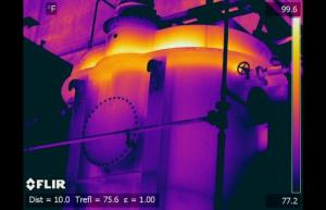 Infrared image shows Nitrogen blanket visible above oil level a on this power plant output transformer - Infrared Imaging Services LLC
