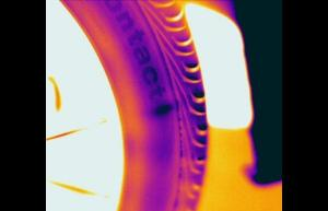 "Infrared image of a bubble in the side wall of a car tire. The bubble is the dark oval shape after the letter ""T"" - Infrared Imaging Services LLC"