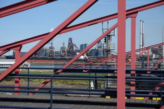 Steel mill seen through a bridge.
