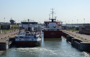 Two ships squeezing side by side into a lock.
