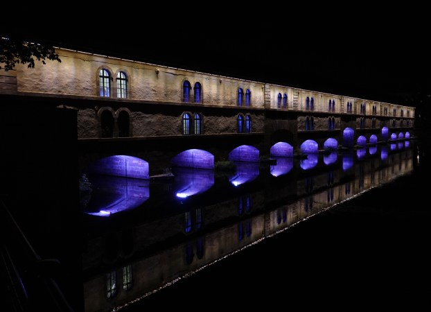 Nighttime view of the covered bridge in Strasbourg.