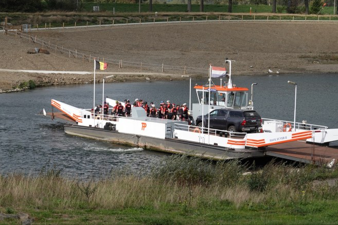 Ferry across the Mass River, loaded with cyclists. Belgium on one bank, the Netherlands on the other.