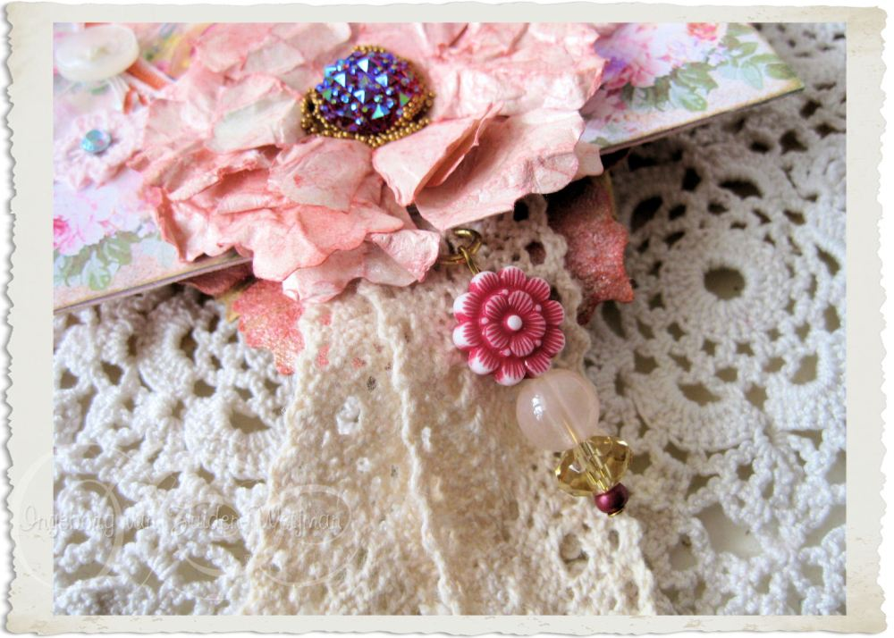Details of lace beaded dangle on notecard hanger