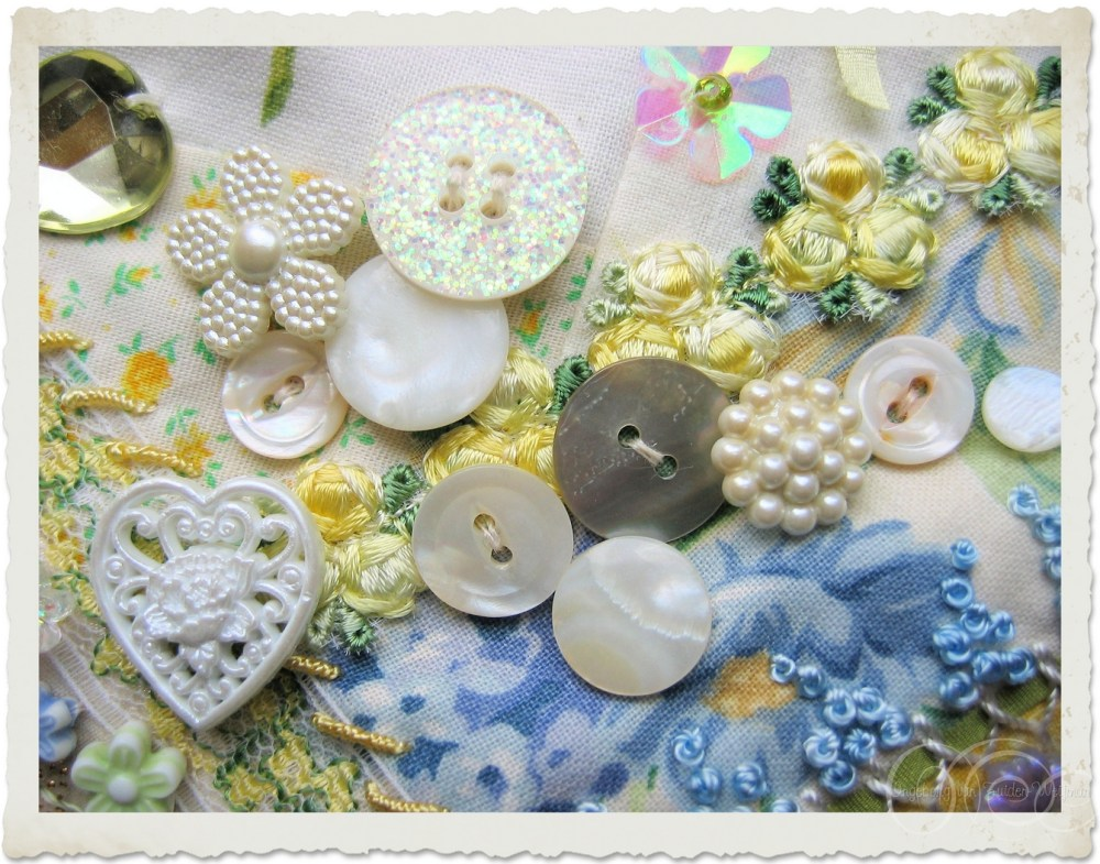 White creme buttons on a crazy quilt by Ingeborg van Zuiden