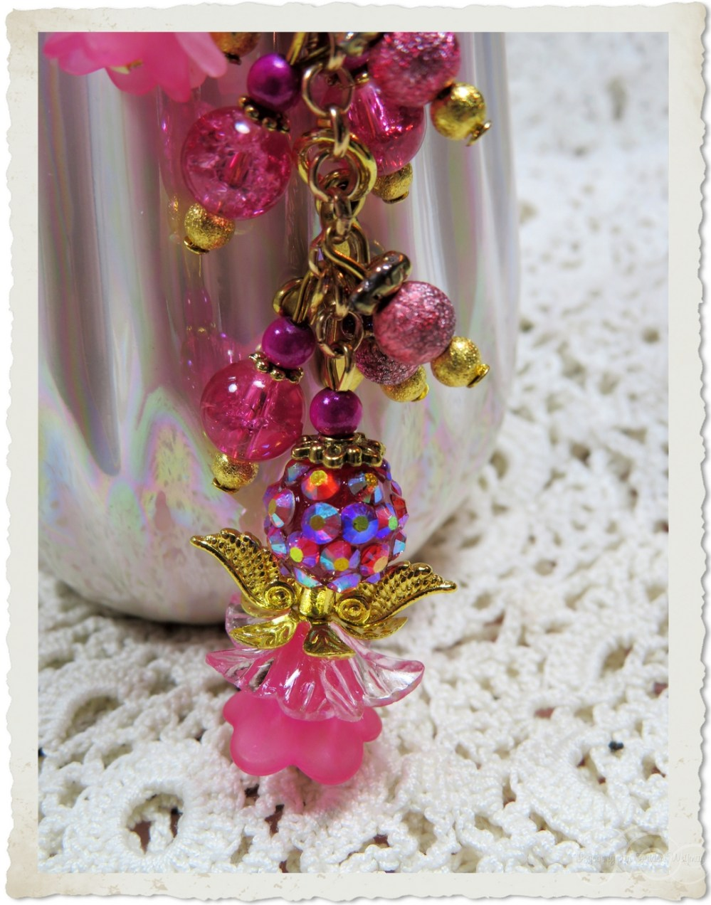 Pink floral angel on a bookmark
