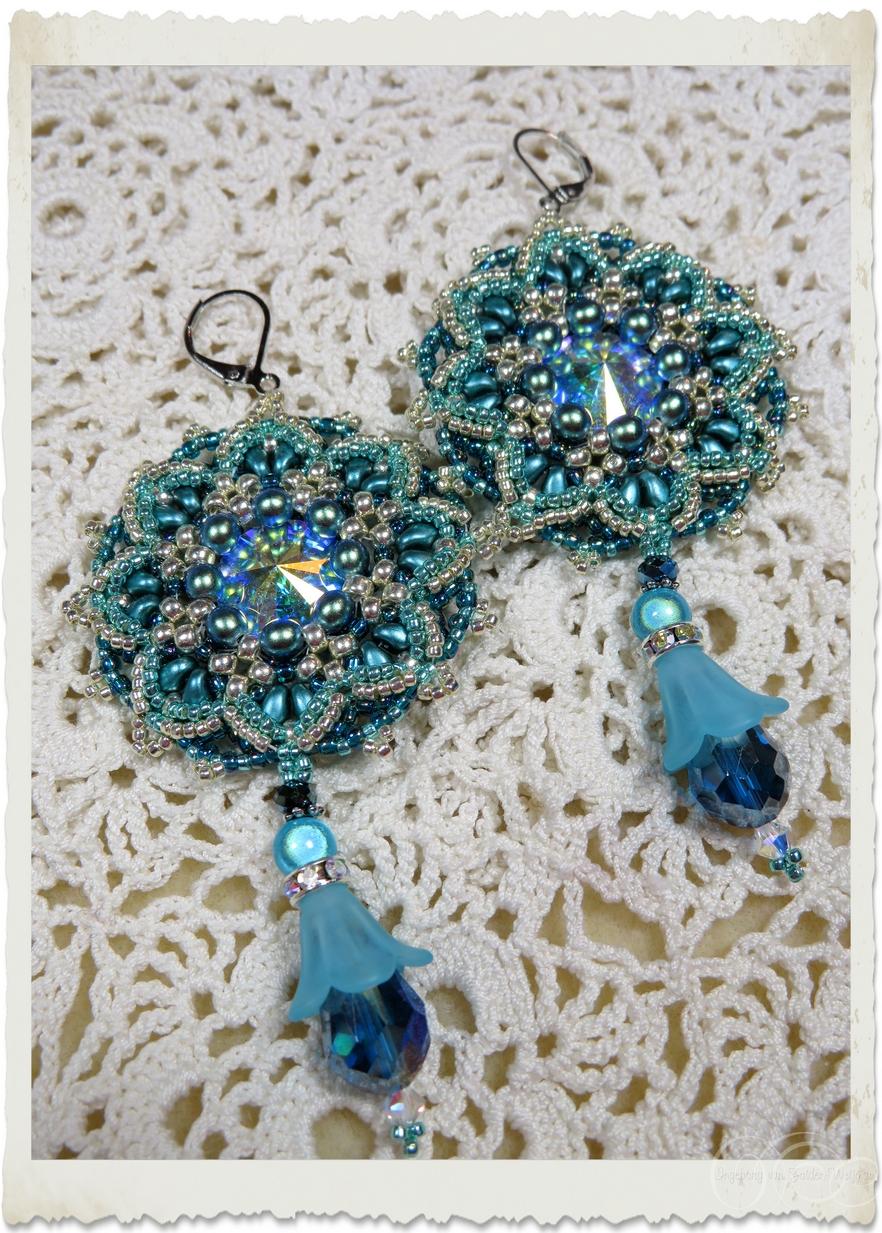 Blue Swarovski pendant earrings with Miyuki beads by Ingeborg van Zuiden