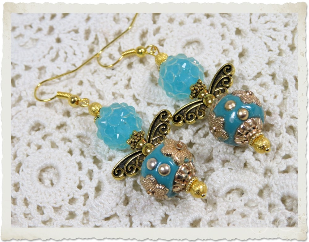 Blue gold angel earrings by Ingeborg van Zuiden
