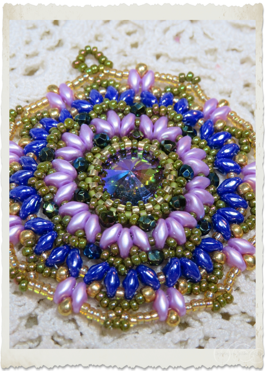Purple beadweaving brooch with superduo and Swarovski rivoli stone