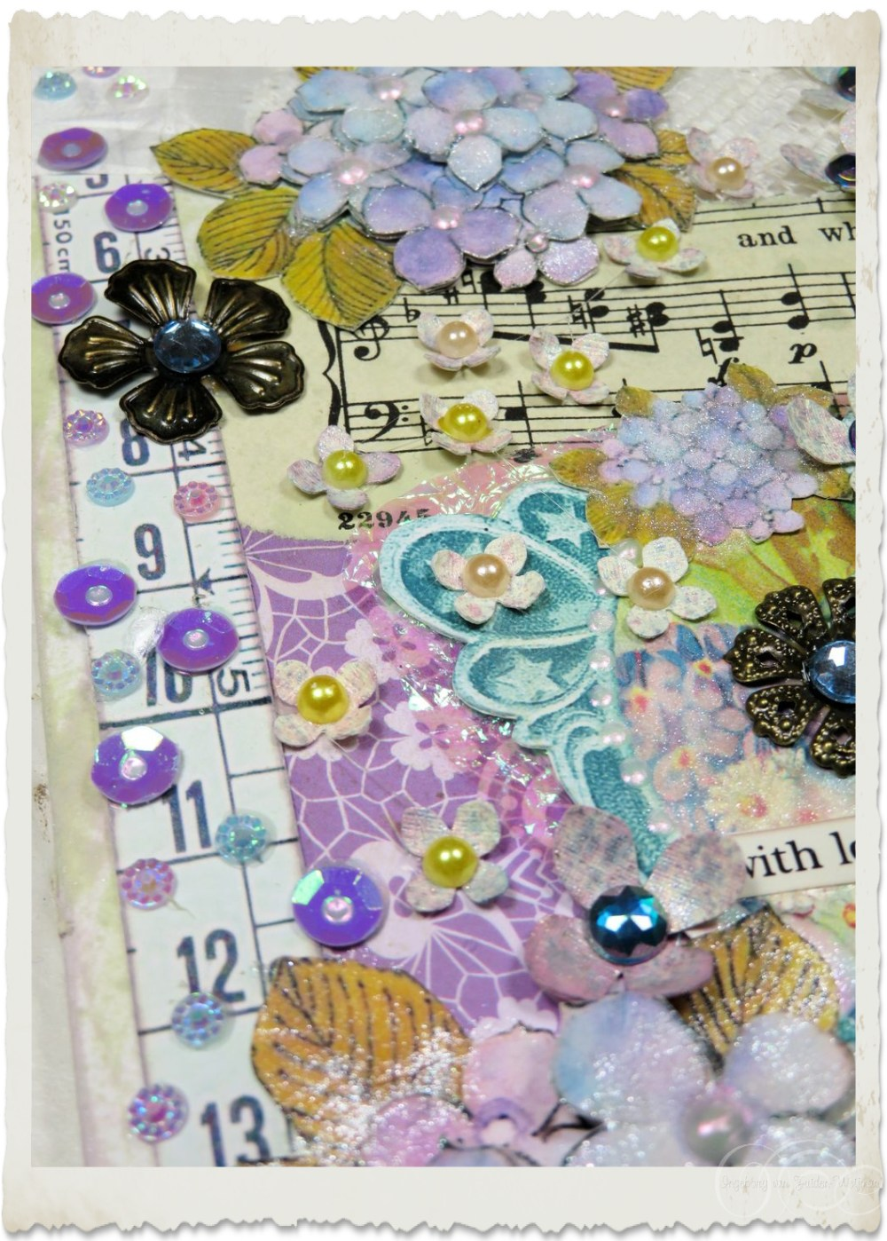 Details of iridescent sequins and paper flowers with pearls