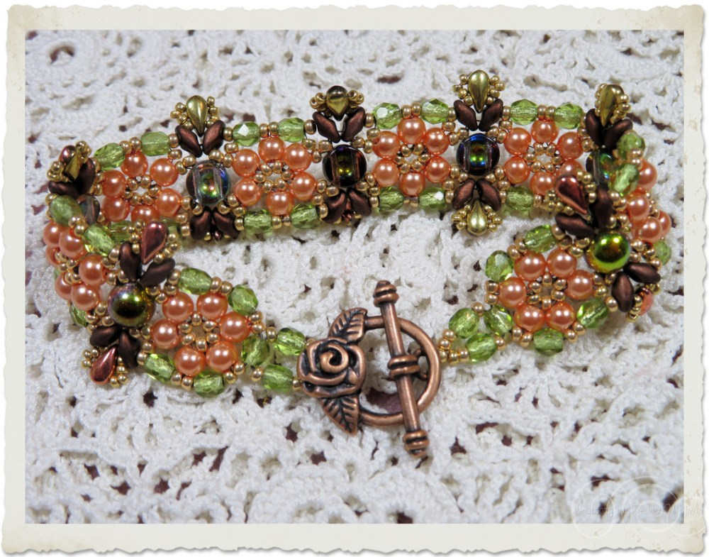 Bronze rose toggle clasp on handmade bracelet with peach flowers and 2-hole cabochon beads