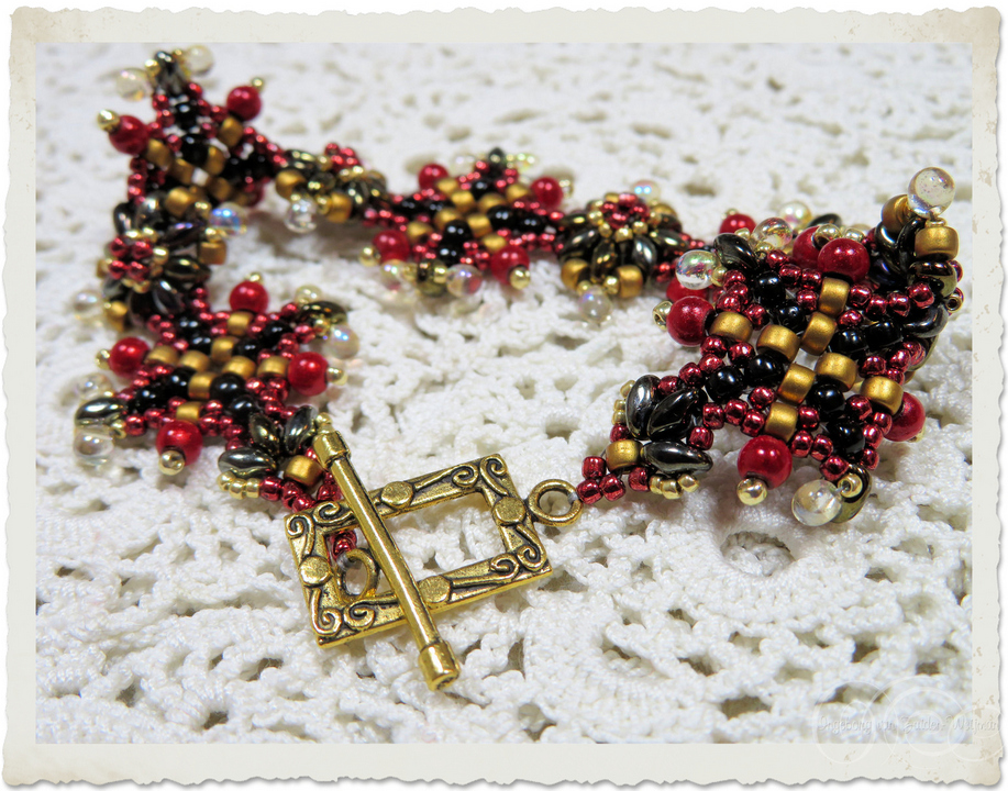 handmade gold black red bead weaving bracelet in medieval style with rectangle toggle clasp