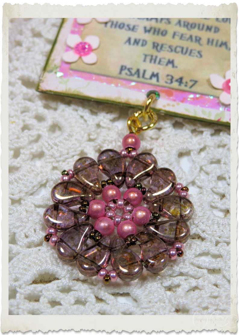Brown pink beaded pendant with miracle beads and paisley beads