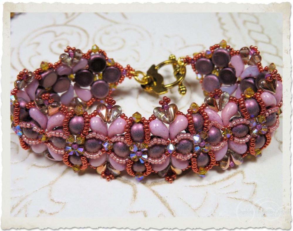Handmade bracelet with Miyuki metallic beads, pink Zoliduo and purple 2-hole 7mm cabochon beads by Ingeborg van Zuiden