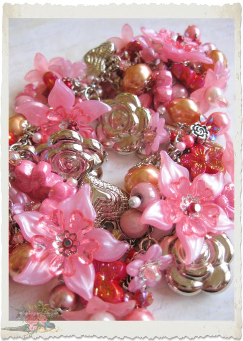 Pink flower charm bracelet by Ingeborg van Zuiden