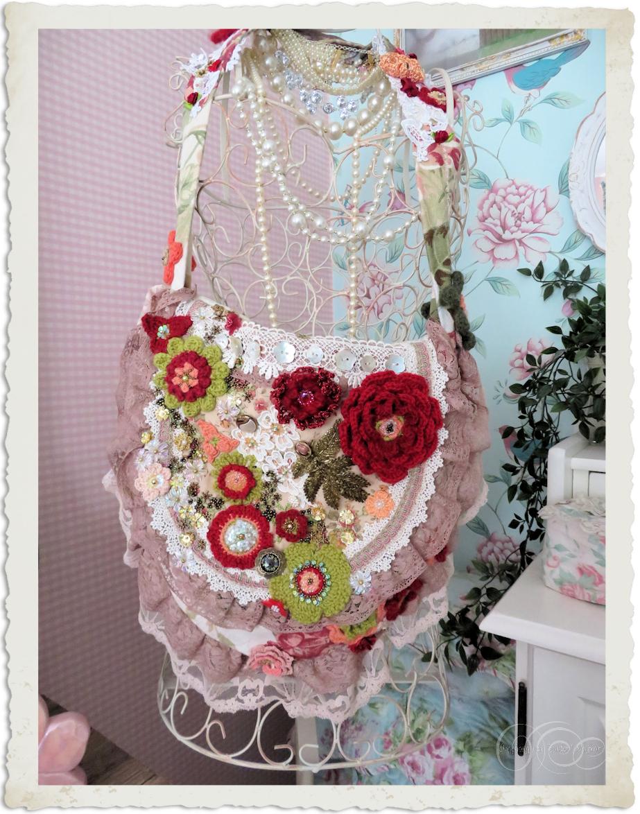 Flower handbag embellished with crochet roses and flowers