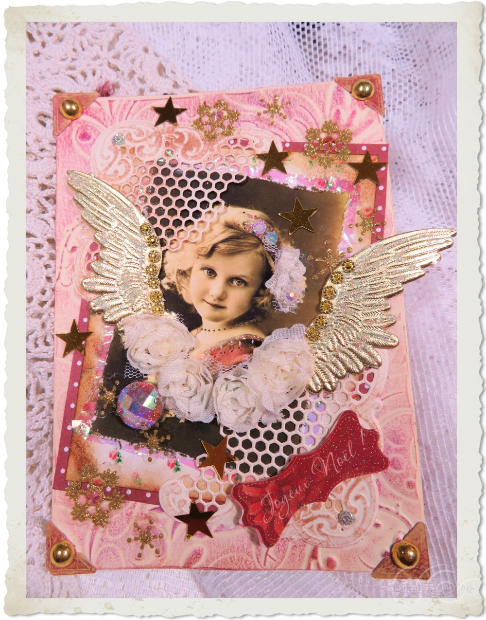 Handmade Christmas card with angel and golden wings