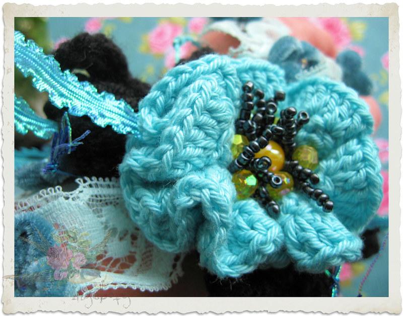 Turquoise black crochet flower on bracelet