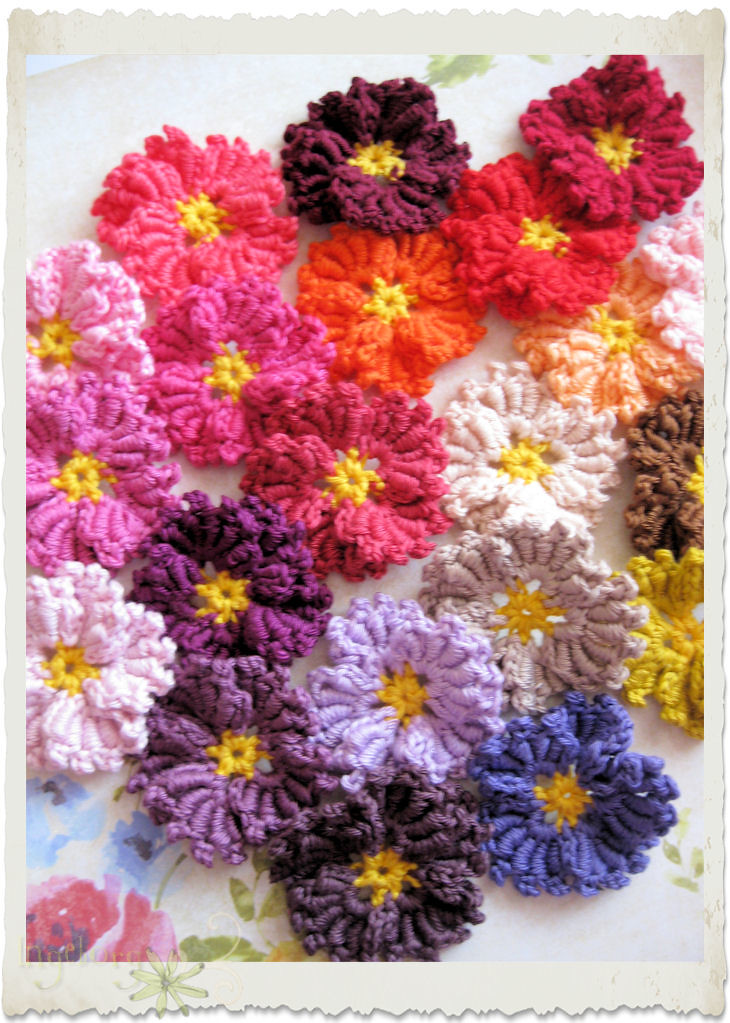 Handmade crochet rainbow bullion flowers by Ingeborg van Zuiden