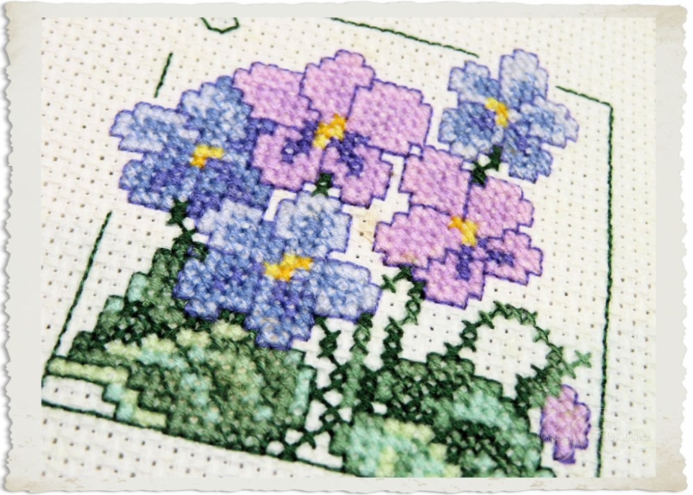 Details of x-stitch violets