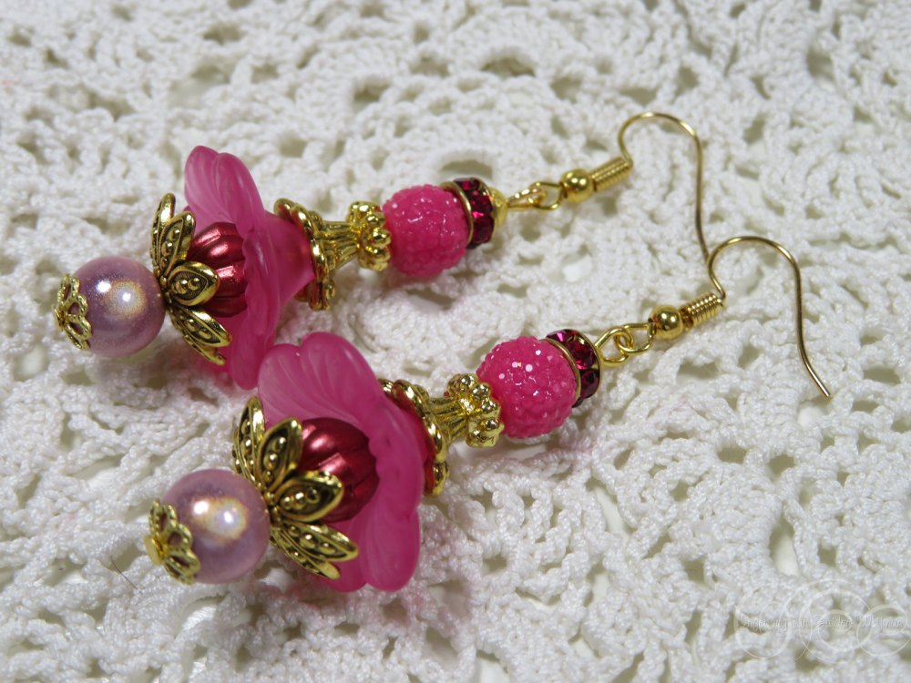 Bright pink miracle flower earrings by Ingeborg van Zuiden
