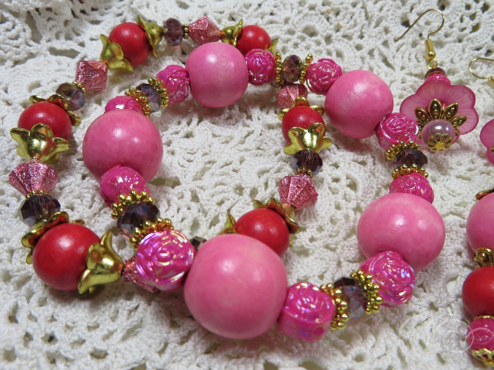 Pink red wooden bracelets with AB rose beads by Ingeborg van Zuiden