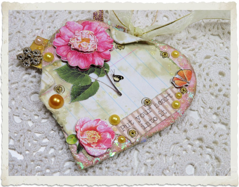 Backside of handmade mixed media heart hanger with pink peony flowers