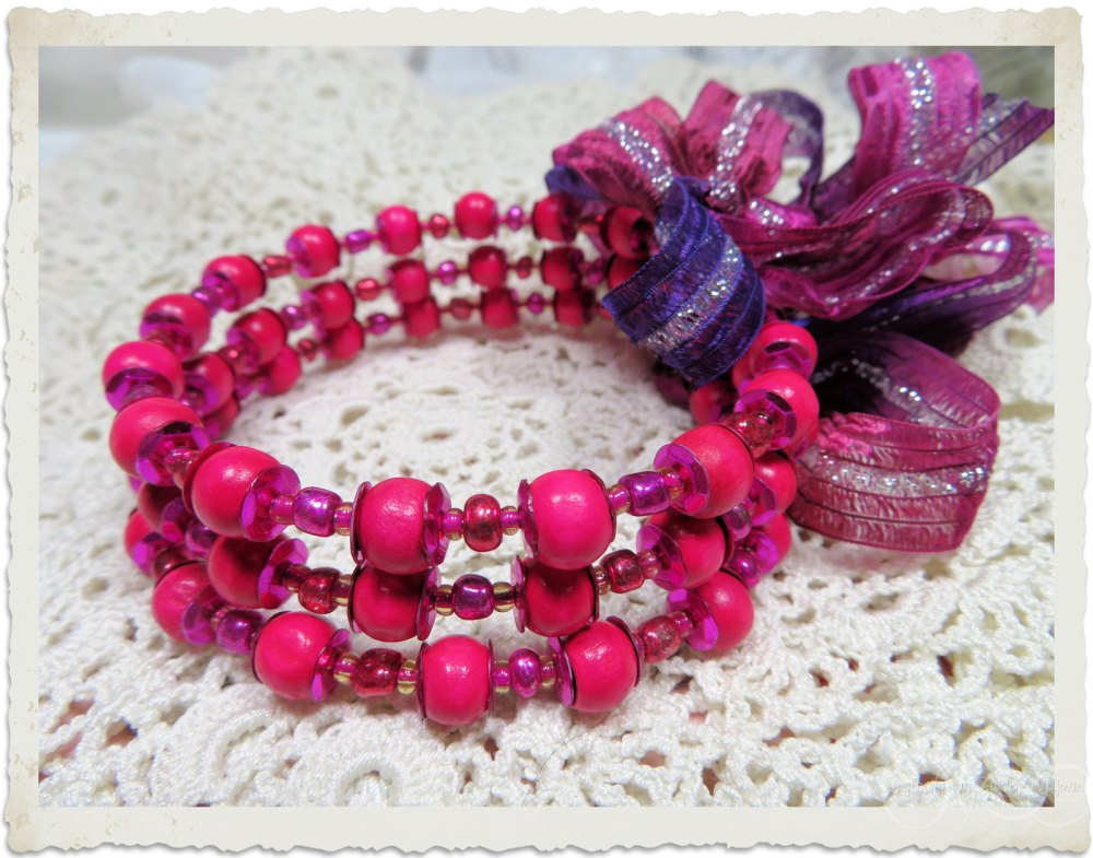 Pink memory wire bracelet with ribbon and sequins