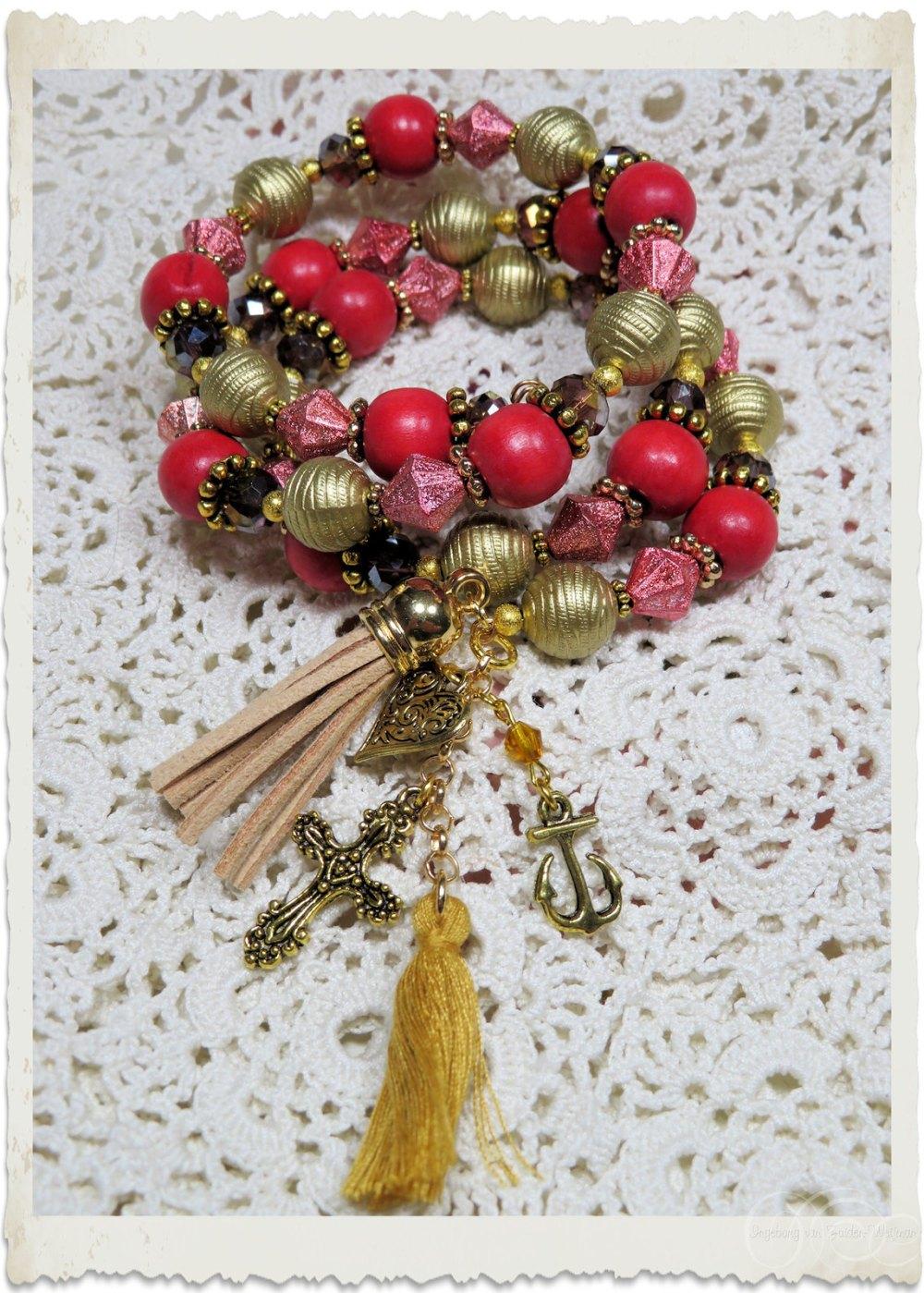 Gold red memory wire bracelet by Ingeborg van Zuiden
