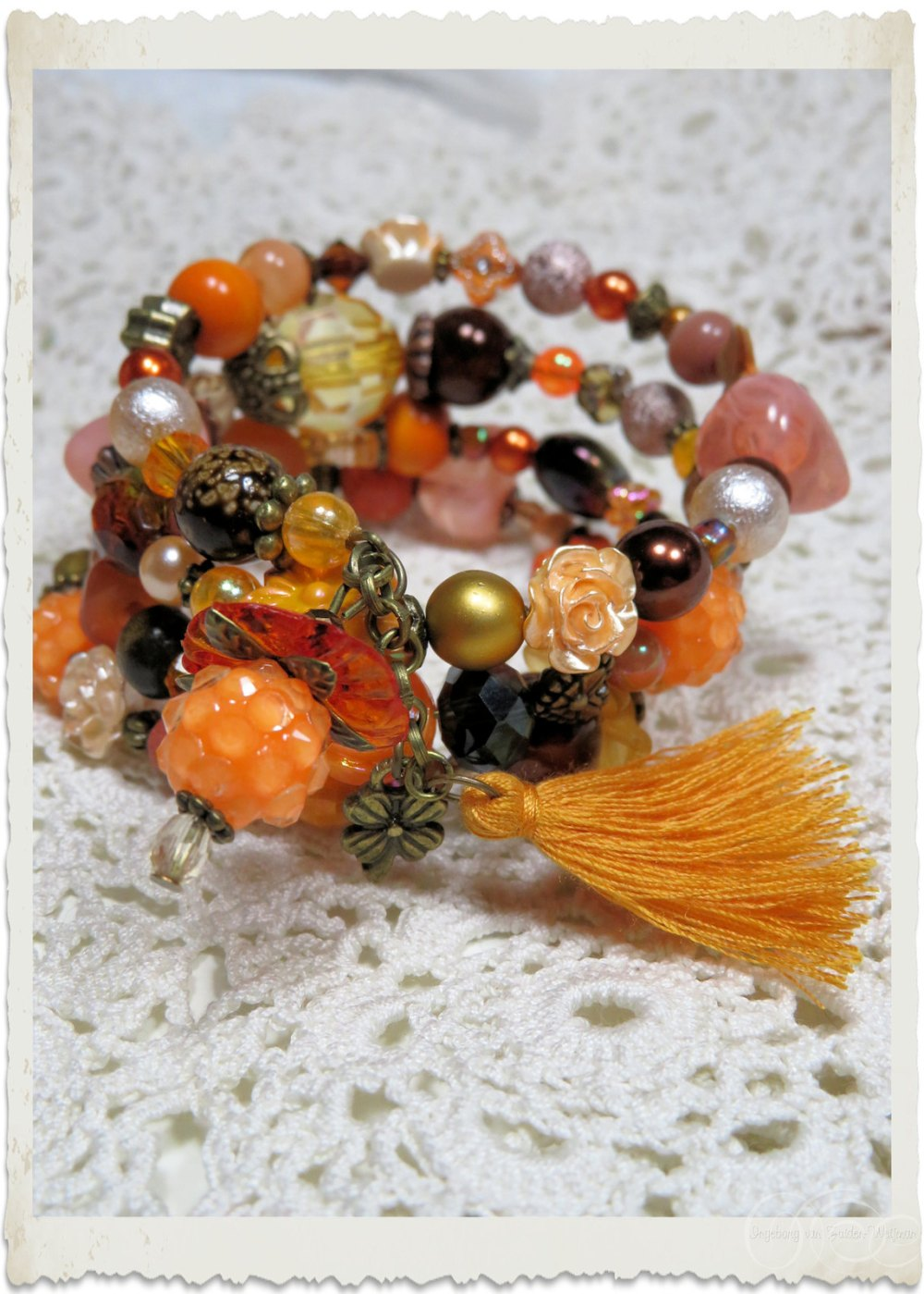 Handmade orange brown gold bracelet with tassel en bronze findings by Ingeborg van Zuiden