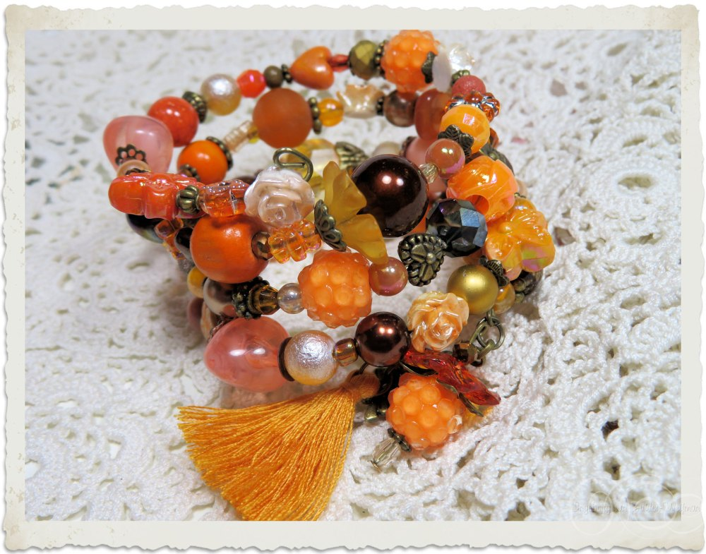 Orange brown peach bracelet with tassel by Ingeborg van Zuiden