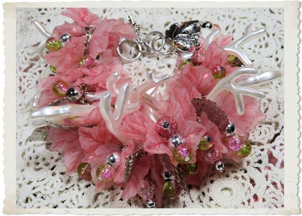 Pink white silver charm bracelet with foliage by Ingeborg van Zuiden