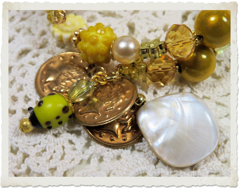 Mother of pearl bead and coins