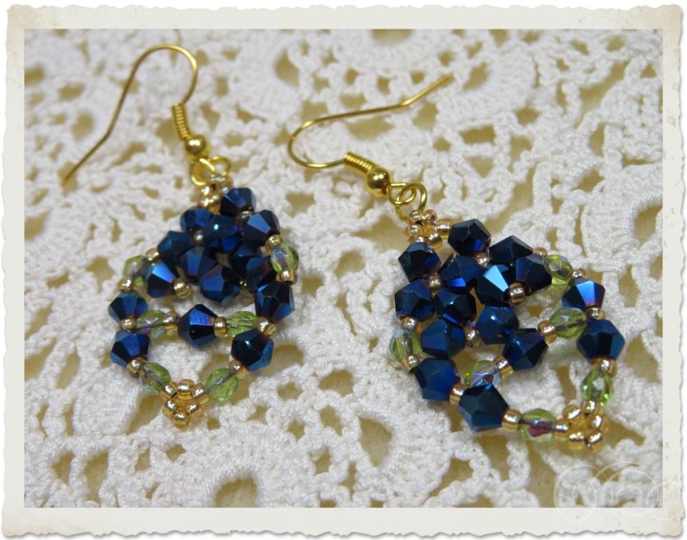 Blue bicone dangling earrings