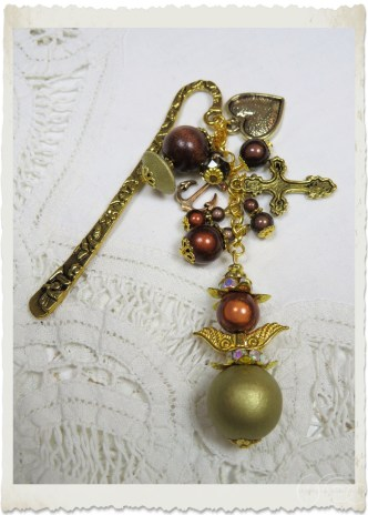 Handmade bookmark with beaded angel and charms