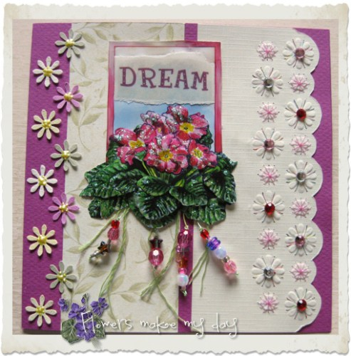 Handmade embroidery card with primula flowers and embroidery