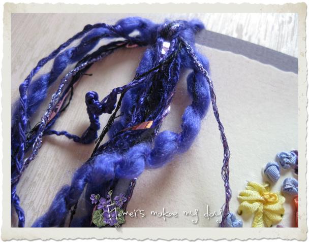 Details of purple fibers on a handmade card